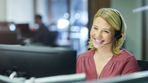 a female call centre worker takes a call.